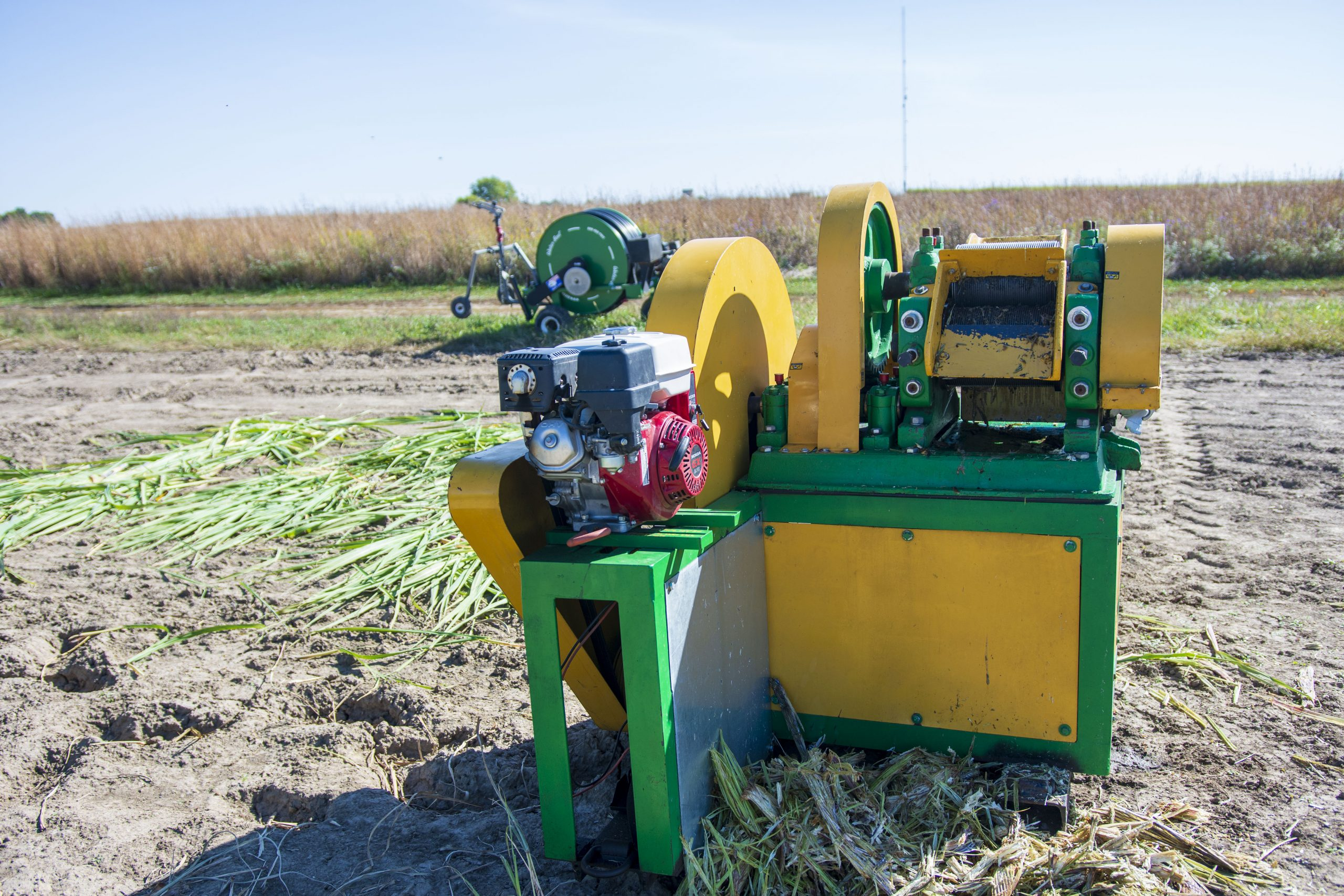 At the Illinois Energy Farm, the juicer is used to immediately process harvested oilcane biomass and recover a valuable oil-sugar mixture.