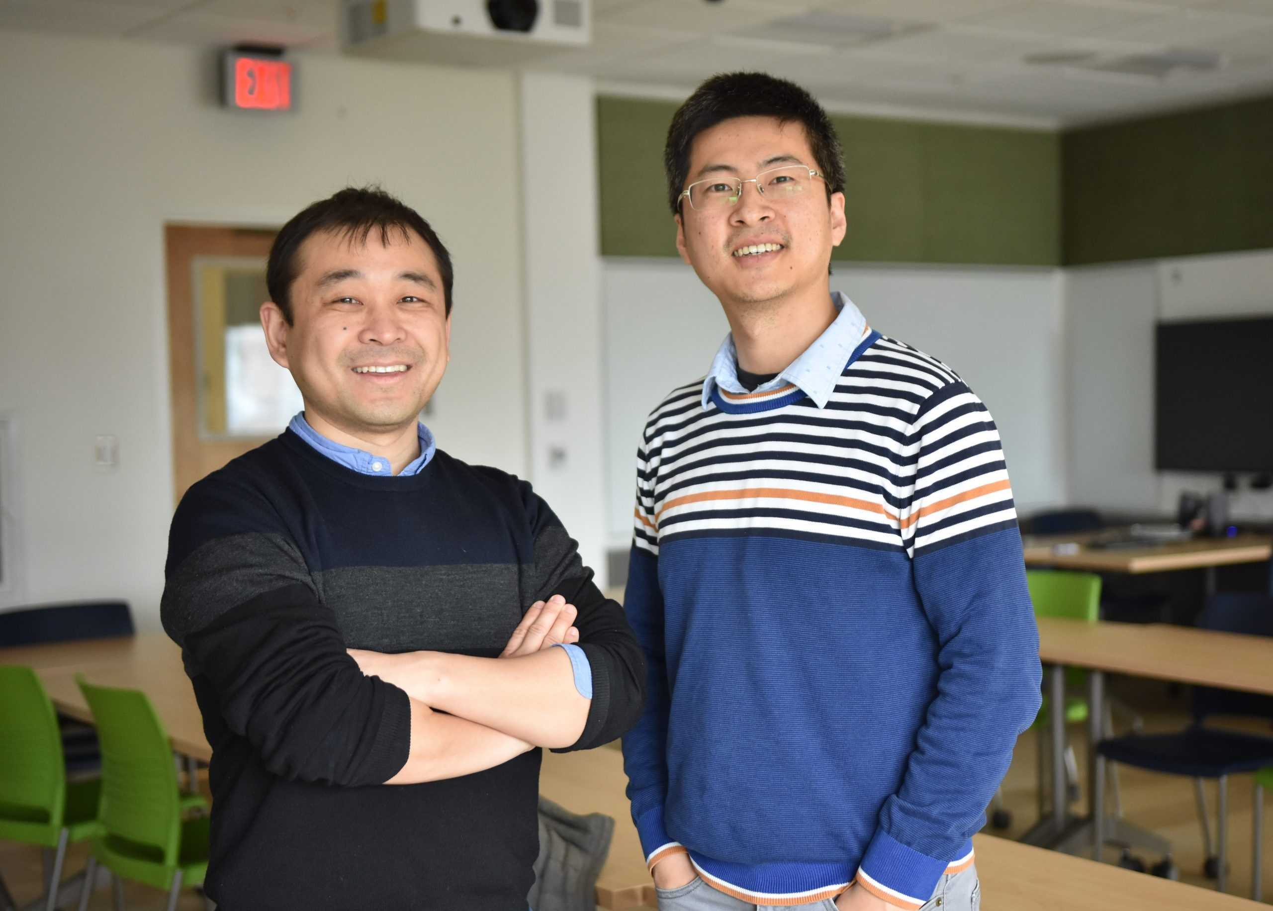 Photo depicts Kaiyu Guan and Chongya Jiang posing in a classroom.