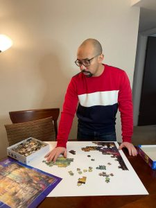Ayman Eid enjoys his free time by putting together a puzzle.